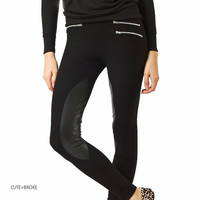 Leggings with leather panels and zippers
