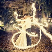 It's a long exposure shot with sparklers :) All they had to do was stand there very still and someone else ran around them with a sparkler. must. do. this.