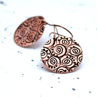 Earrings of copper art clay with spirals