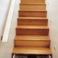 Staircase with opening drawers.