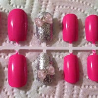 Pink, Light pink and blue sparkle nails with silver accent nails and bows