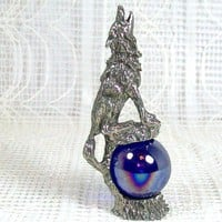 Pewter Wolf Sitting on a Glass Ball