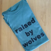 Raised by Wolves - adult tshirt (unisex S - blue)