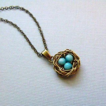 Bird Nest Necklace With Tiny Blue Eggs by pinkingedgedesigns