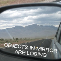 Objects in mirror are losing vinyl decal for sideview mirror