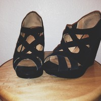 black suede wedges.