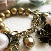 Vintage Pearl& Camellia& Hollow Butterfly& Leaf Beaded CharmStrand Bracelet at online cheap fashion jewelry store Gofavor