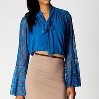 Faye Tie Back Lace Panel And Bell Sleeve Blouse at boohoo.com