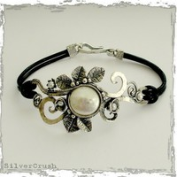 Sterling silver leaves with pearl on a black by silvercrush