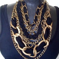 Antique gold chain necklace with black jersey braids