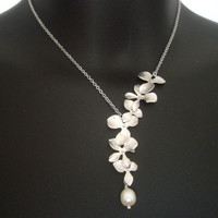Asymmetrical flowers cascade necklace in white by atlantisjewelry