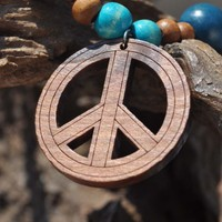 Wooden necklace with peace sign in blues and browns