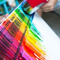 Glue crayons to board/canvas, melt with hairdryer, let cool