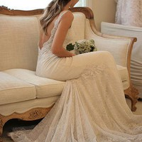 Weddings / Beautiful backless lace wedding dress.