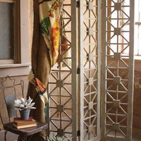 rustic wooden room divider with x design