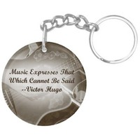 Music Expresses that guitar photo saying Acrylic Key Chains from Zazzle.com