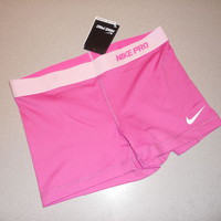 NIKE WOMEN FITTED SHORTS...