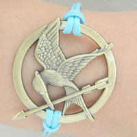 Hunger games bracelets, retro bronze arrows, blue wax line inspired bracelet