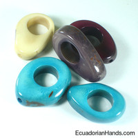 Two Sides Nut with Hole 19mm Tagua Bead | Tagua Bead for Beading Jewelry: Nuts | EcuadorianHands.com