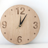 Wall clock made out of solid oak, convex round shape minimalistic style