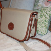 Vintage Dooney Bourke Purse with long Crossbody strap.