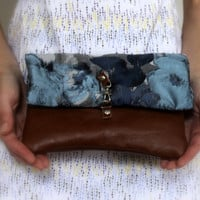 Fold over clutch, blue floral fabric and leather.
