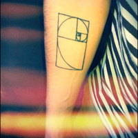 golden spiral tattoo