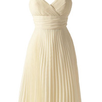 Ma pleated chiffon dress in pale yellow. |