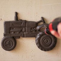 cast iron tractor shaped wall mounted bottle opener