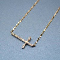 SWAROVSKI SIDEWAYS CROSS NECKLACE IN GOLD