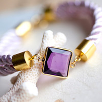 Beauty faceted Amethyst gemstone in 22k gold bezel by pardes
