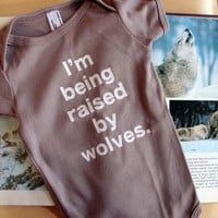 Baby Onesuit I&#x27;m Being Raised By Wolves 612mo by eggagogo on Etsy