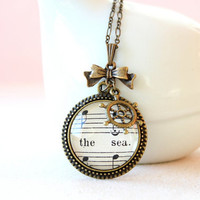 Nautical necklace.  Vintage sheet music pendant with bow and steering wheel charms.  Maritime accessory for women