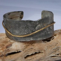Textured sterling silver and bronze bracelet by kitkingdesigns