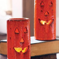 rustic jack-o-lantern luminaries with orange glaze