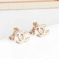 rose gold plated cc logo Chanel crystal clear bows earrings