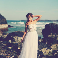 strapless lace wedding dress with handmade flowers applied over the bust, soft tulle skirt