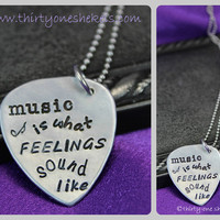 Music is what Feelings Sound Like Guitar Pick by thirtyoneshekels