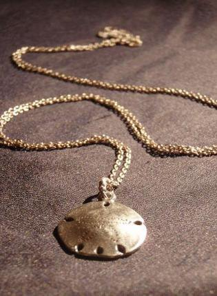 Jewelry - sterling silver Sand Dollar necklace | UsTrendy