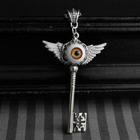 Winged skeleton key necklace with orange/brown eyeball cabochon - gothic - steampunk jewelry