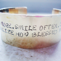 Wide brass statement cuff hand stamped with inspirational words
