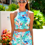 Tropical Floral Print Sleeveless Crop Top with High Neckline