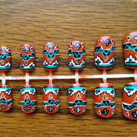 Paprika and turquoise tribal design by JardinDesigns on Etsy