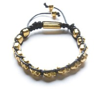 Black Bracelet with Gold Skull Beads