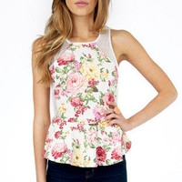 Flow and Mesh Peplum Top $32