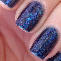 "Nail polish - ""Blueprint"" blue and purple glitter in a dark blue base"