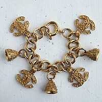 Free People  Vintage Chanel Charm Bracelet at Free People Clothing Boutique