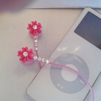 Back in stock.  Ocean Pink Coral earbuds with swarovski crystals