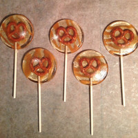Salted caramel drizzled pretzel lollipops