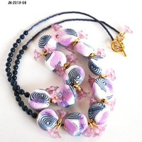 Purple and Navy Blue Swirl Beaded Necklace with purple trumpet flowers